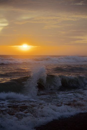 Beach Beauty In Nature Force Horizon Over Water Motion Nature No People Power In Nature Scenics Sea Sky Sun Sunset Water Wave