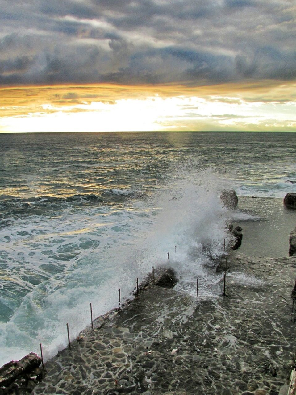 sea, cloud - sky, sky, nature, water, beauty in nature, wave, beach, scenics, no people, sunset, tranquility, outdoors, tranquil scene, horizon over water, motion, day, storm cloud, power in nature, force