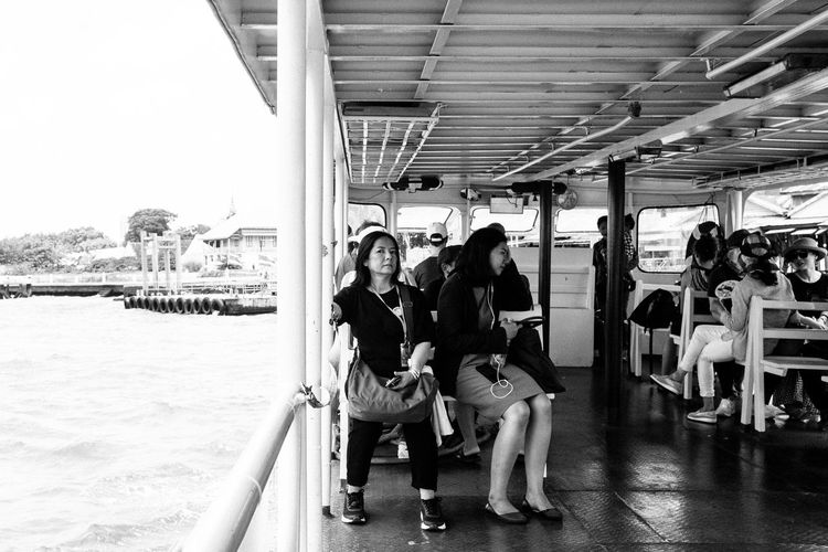 Busted Fujifilm_xseries Bangkok Thailand Group Of People Real People Women Sitting Leisure Activity Lifestyles Full Length Transportation Men Adult Incidental People People Travel Day Looking At Camera Mode Of Transportation Water Seat Togetherness Casual Clothing Outdoors