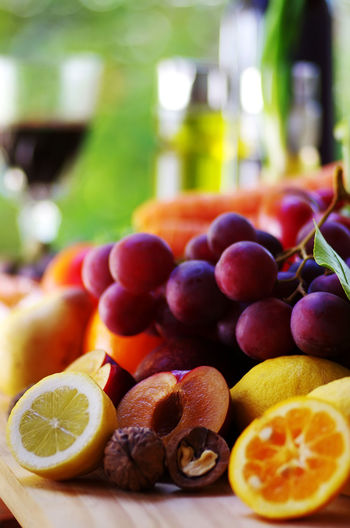 bunch of grapes, plums and citic fruits Citrus Fruit Food Food And Drink Freshness Fruit Glass Grapes Healthy Eating Lemon Orange Orange - Fruit Plum Refreshment Selective Focus SLICE Table Wellbeing