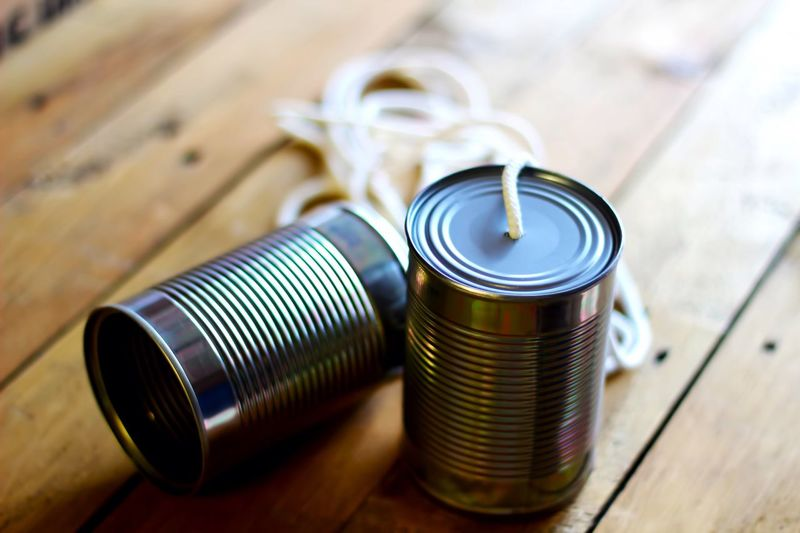 Tin can phone on table