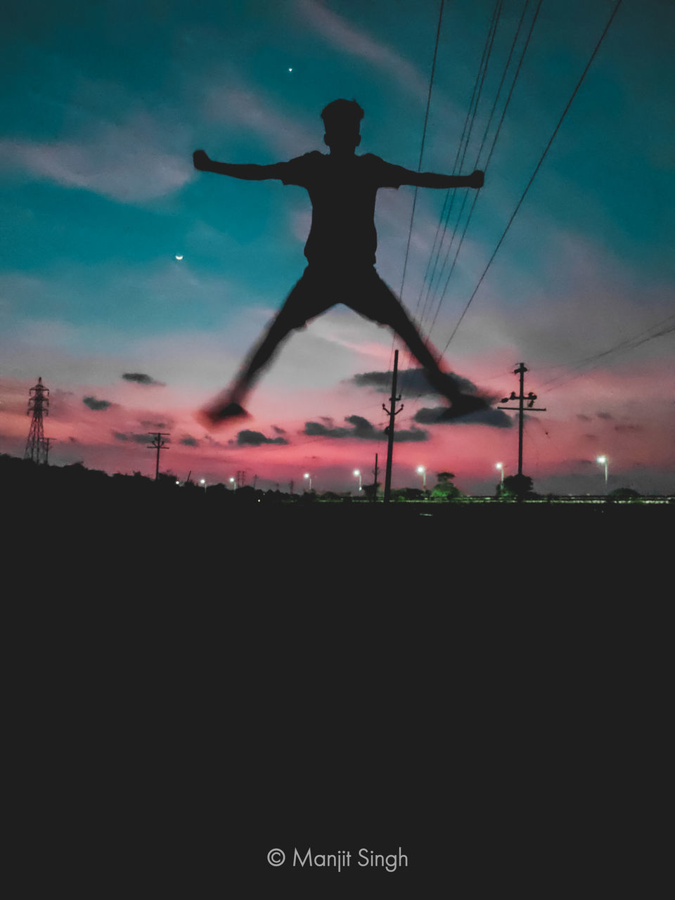 SILHOUETTE MAN WITH ARMS OUTSTRETCHED AGAINST SKY DURING SUNSET