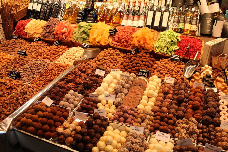 Various fruits and chocolats for sale at market