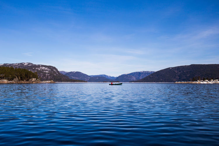 Kayaking in the fjords. Beauty In Nature Blue Boat Day Fjord Fjordsofnorway Kayaking Kayaking In Nature Mountain Norway ✌ Outdoors Rippled River Riverside Scenics Sea Sky Water