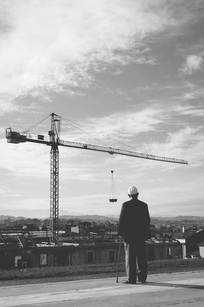 Observing Observing The World People Watching Crane - Construction Machinery Progress Development Bnw B&w Blackandwhite Black And White Black & White Bnw_life people and places Peace And Quiet Fleeting Moments Fleeting City Standing Silhouette Full Length Sky Cloud - Sky