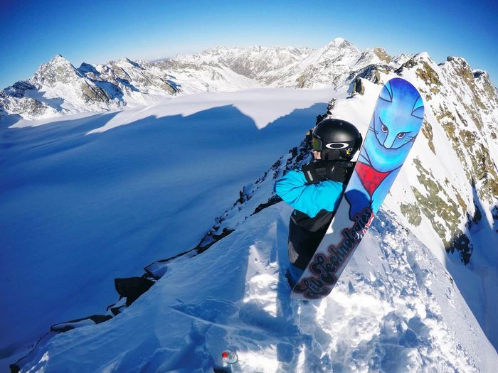 Snow Sports After reaching the peak Snow Winter Mountain Cold Temperature Adventure Full Length Mountain Range Ski-wear Sport Outdoors Ski Goggles Ski Holiday One Person Vacations Skiing Extreme Sports Landscape Day Winter Sport Real People