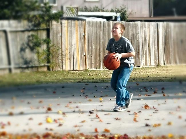 Sport In The City Urban Sports Young Boy Basketball Shooting Ball Playground Solo Playing Alone Exercise After School Action Shot  Basketball Court EyeEm Best Shots Ladyphotographerofthemonth Persistence  Focused In The Zone Determination Practice Suburban Sports Neighborhood Park In Motion