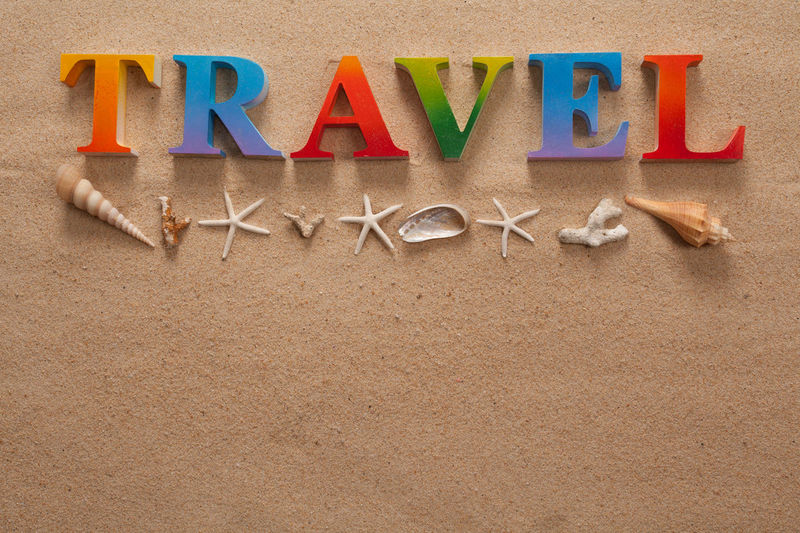 top view of travel written in colorful letters decorate with shellfish on the beach with copy space Alphabet Art And Craft Capital Letter Communication Creativity High Angle View Indoors  Land Large Group Of Objects Letter Message Multi Colored No People Sand Single Word Studio Shot Text Western Script