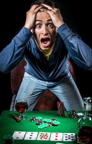 Poker player. Gambling concept Blackjack Casino Emotions Gambling Jackpot Man Poker Addiction Casino Entertainment Expression Gambler Gambling Gambling Chip Game Leisure Games Male Player Playing Playing Card Games Poker - Card Game Poker Chips Poker Game Studio Shot Young Adult
