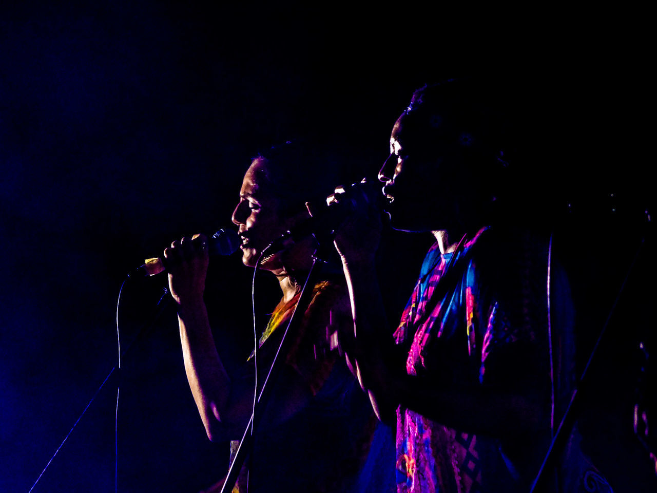 Two Women Singing On Stage