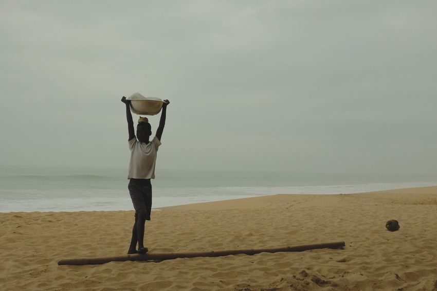 Beach, Ghana Ghana Travel West Africa Africa Beach Full Length Horizon Over Water One Person Outdoors Real People Sand Sea Shore Standing Water The Street Photographer - 2018 EyeEm Awards