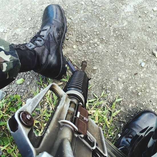 M16 Human Leg Shoe Low Section One Person High Angle View Real People Day Human Body Part Outdoors Men Standing Weapon One Man Only Close-up People