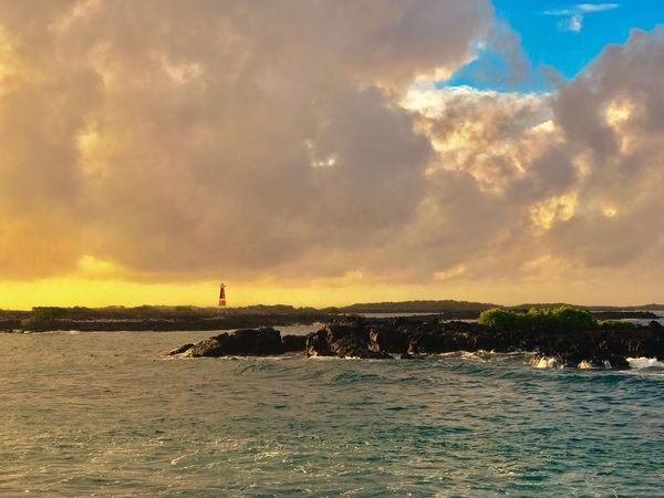 Clouds Cloudy Lighthouse Orange Sky Dramatic Sky Sunset Dawn Sea Ocean Sky Cloud - Sky Water Beauty In Nature Nature Scenics No People Tranquility Outdoors Horizon Over Water Architecture Day Idyllic Rocks The Great Outdoors - 2017 EyeEm Awards