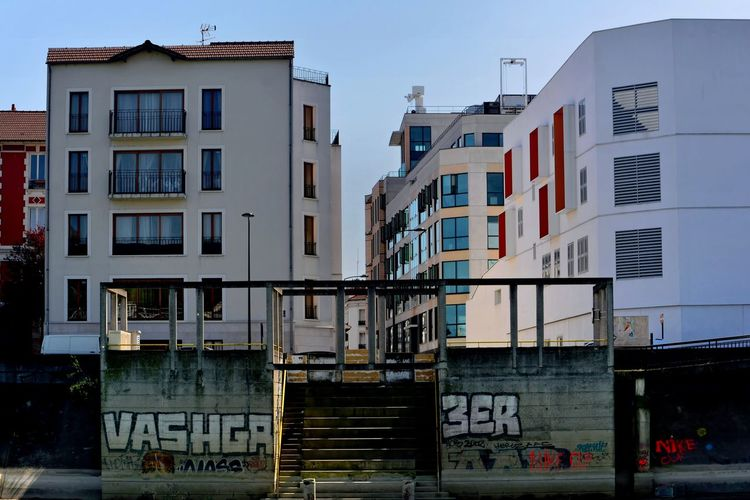 Marne river banks Apartment Architecture Building Building Exterior Built Structure City City Life Communication Day Graffiti House No People Outdoors Residential District Sky Text Window