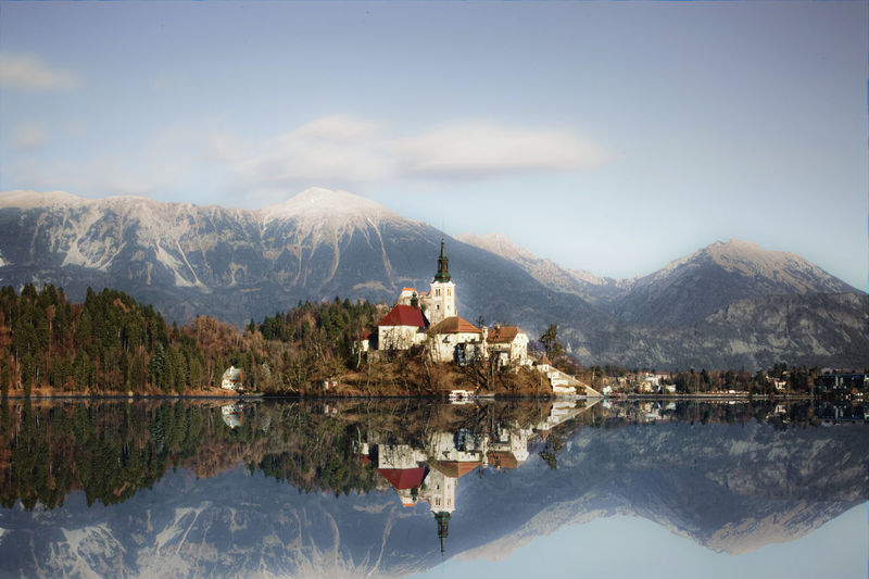 View of lake bled with snowcapped mountain in background