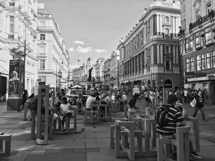 Vienna modern benches Bnw_friday_eyeemchallenge Bnw_benches Building Exterior Architecture Built Structure City Building Street Group Of People Crowd Outdoors Travel City Life