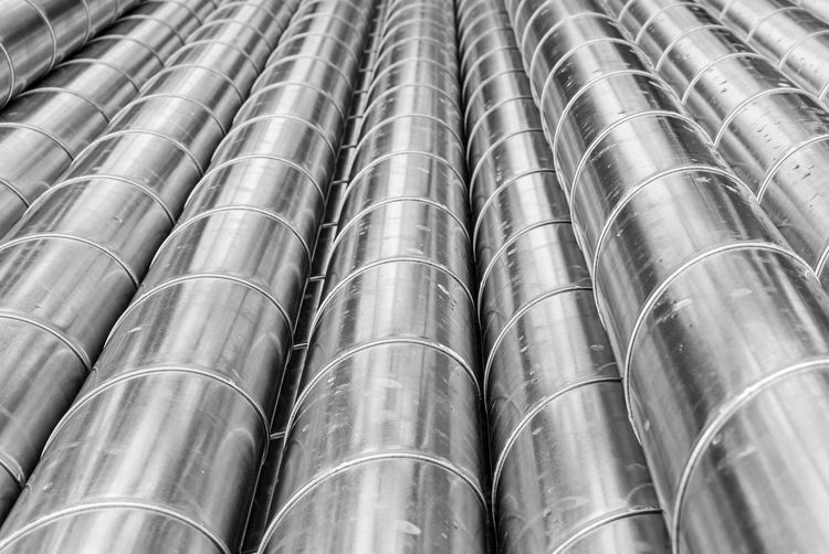 Metal Metal Industry Aluminum Pipes Industry Industrial Black And White Business Finance And Industry Products Man Made Structure Pattern Reflections Business Tubes Full Frame Backgrounds No People Pipe - Tube Repetition Close-up Cylinder Still Life Side By Side Day Steel In A Row Pipeline Large Group Of Objects Outdoors Food And Drink Silver Colored Alloy
