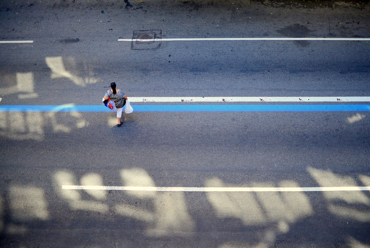 EyeEm Best Shots Eye4photography  Getting Inspired Aerial View Streetphotography Urban Urban Geometry Urbanphotography Light And Shadow Lines Asphalt Road Street Real People City Road Marking Lifestyles Full Length Outdoors High Angle View The Street Photographer - 2019 EyeEm Awards