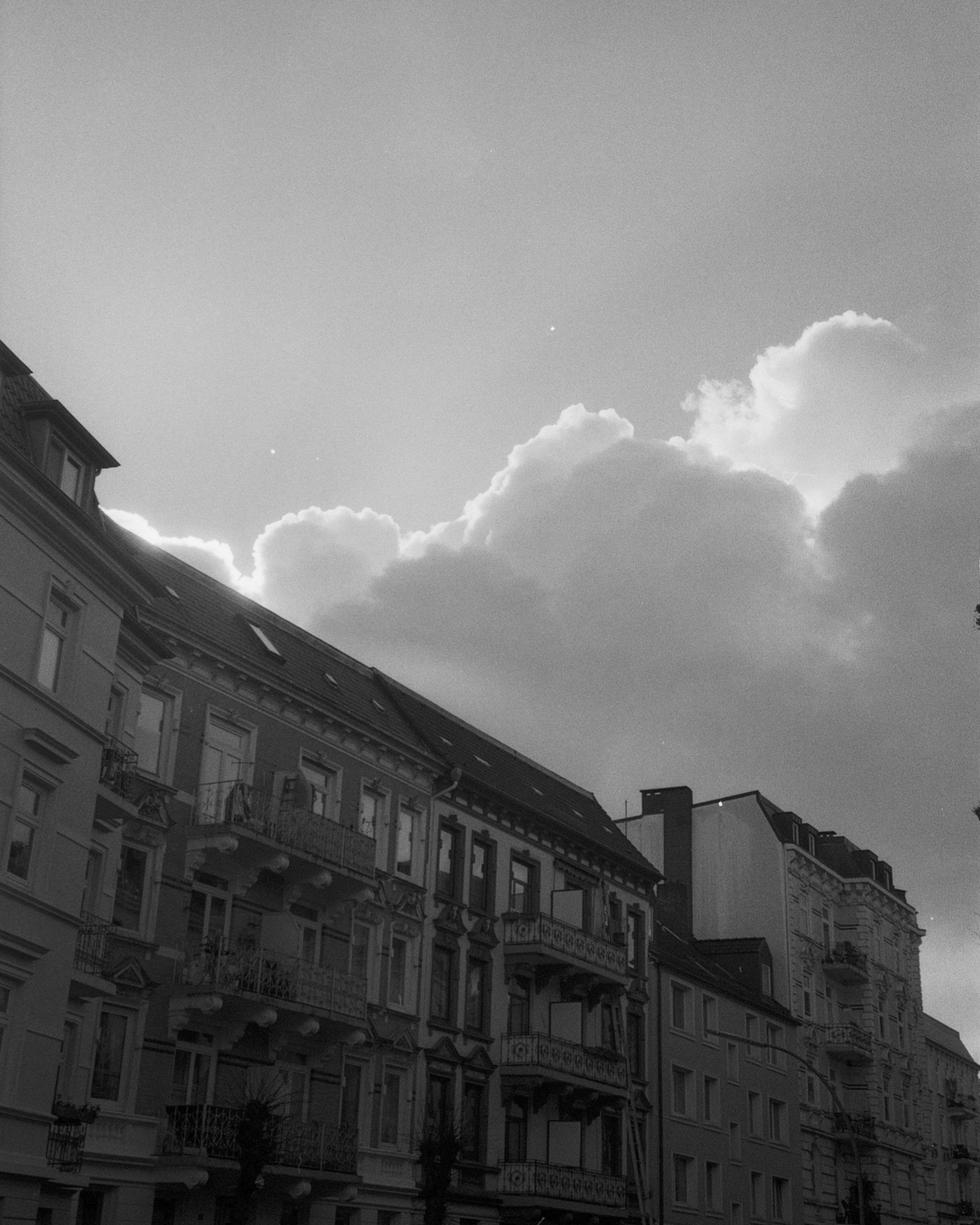 architecture, building exterior, built structure, black and white, sky, monochrome, cloud, city, monochrome photography, building, low angle view, nature, darkness, black, white, no people, residential district, cityscape, house, outdoors