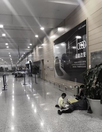 Real People Airport Waiting Boy Shanghai, China Tired Delay Flight Exhausted Late Night