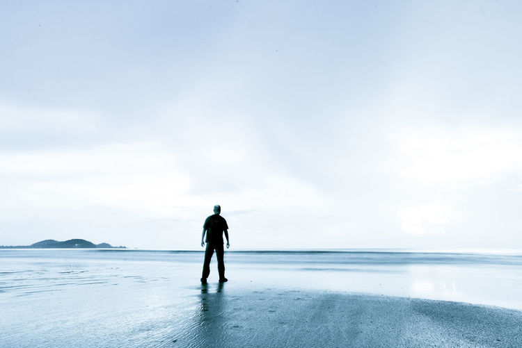 Silhouette Man Walking On Beach