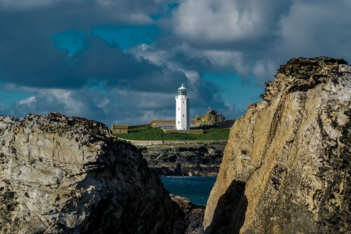 Godrevy Lighthouse, taken from another angle Dark Skies English Coastline English Countryside EyeEm Best Shots EyeEmNewHere Getty Lighthouse Architecture Beach Boulders Cliff Coast Cornwall Godrevy Godrevy Lighthouse Island Nature No People Outdoors Rocks rule of thirds Scenics Sea Shadows Water EyeEmNewHere