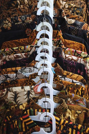 Batik Day High Angle View No People Nature Decoration Arrangement Sunlight Abundance Belief Built Structure Pattern Architecture Seat Religion Large Group Of Objects In A Row Outdoors Chair White Color