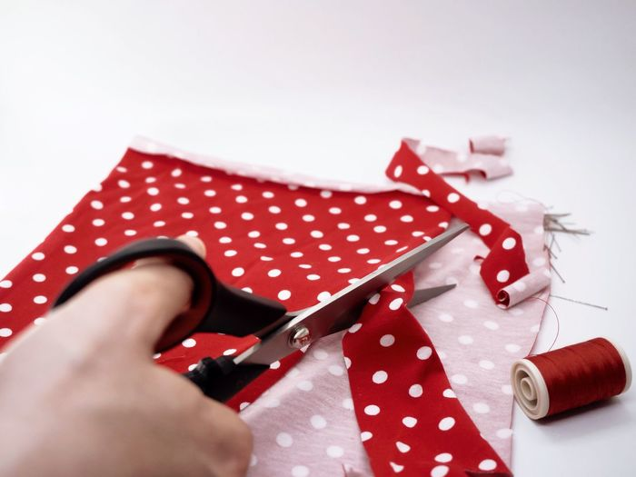 Handmade Fabric Polka Dot Scissors Sewing Working Hands Workingplace Handcraft Art And Craft Polka Dot One Person Scissors Human Hand Human Body Part Holding Spotted Red Close-up Real People White Background Adult