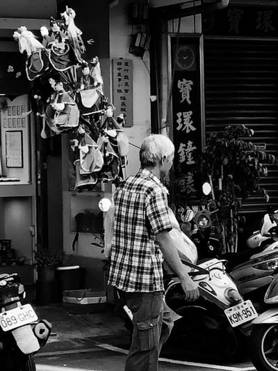 Street/Outdoor/Black and White Photography series: Puppets vendor on the street Nankan, Taoyuan, Taiwan Black And White Photography Outdoor Photography Street Photography Puppets At Street Real People Men City Built Structure Street Architecture Lifestyles One Person Adult Casual Clothing Day Leisure Activity Standing Market Incidental People The Street Photographer - 2018 EyeEm Awards The Traveler - 2018 EyeEm Awards