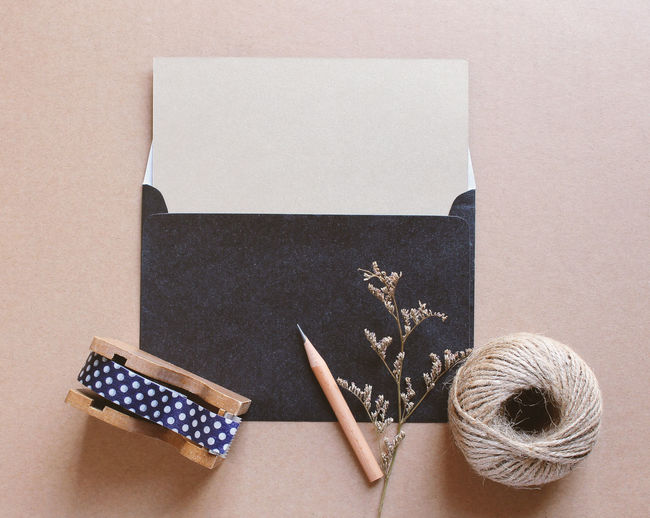 Copy Space Art And Craft Blank Card Cardboard Container Craft Creativity Directly Above Envelope Gift Greeting Card  Group Of Objects High Angle View Indoors  Letter Masking Tape Medium Group Of Objects No People Package Paper Pen Still Life Studio Shot Table