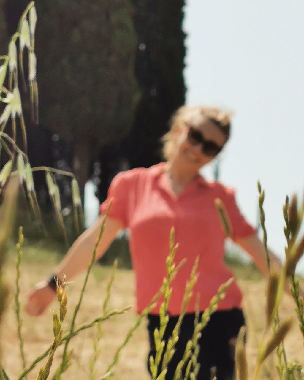 WOMAN WALKING ON A FIELD