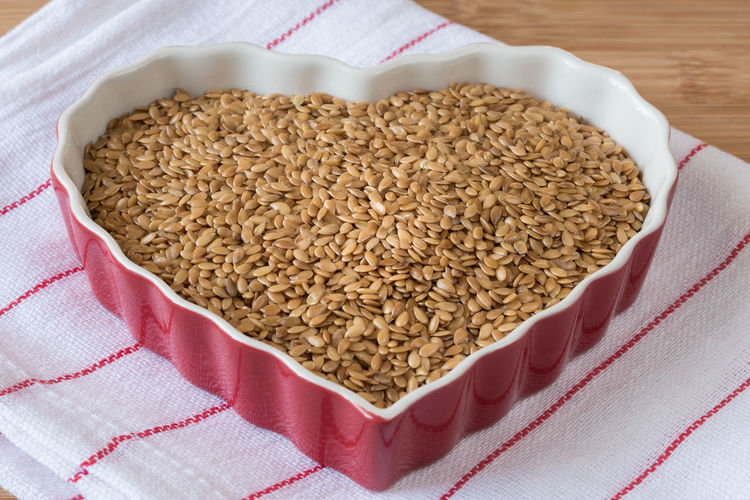 Heart healthy flaxseeds Close-up Flax Seeds Flaxseeds Food Healthy Healthy Eating Heart Isolated Love Shape Valentine