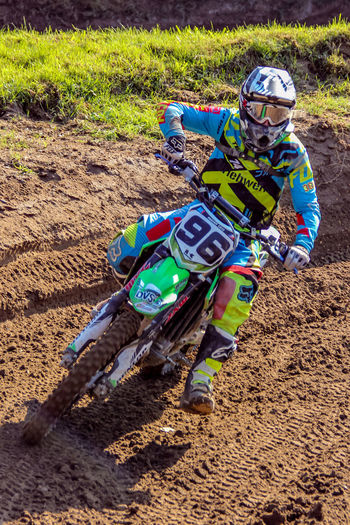 Motocrossrace Land Field Dirt Day Full Length Headwear One Person Men Helmet Nature Leisure Activity High Angle View Real People Mud Childhood Sport Outdoors Sunlight Riding Motocrossrace