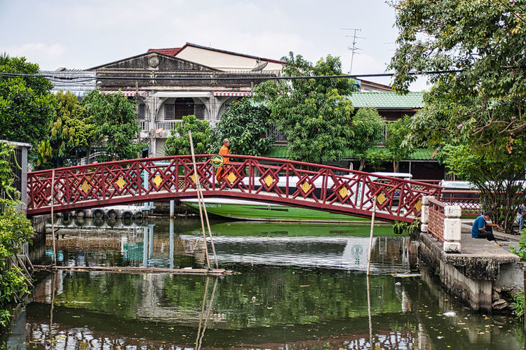 Bridge over river by building