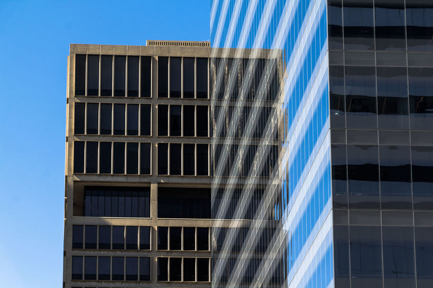 Composition Office Reflection Architecture Backgrounds Blue Building Exterior Built Structure Day Low Angle View No People Office Building Outdoors Sky Window The Graphic City
