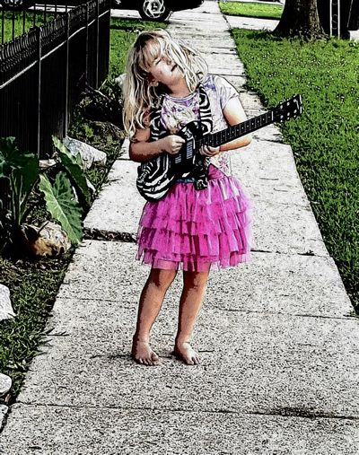 Adult Child Childhood Children Only Day Full Length Girls Guitar Chi Leisure Activity Little Girl Little Rock And Ro Music Musician One Girl Only One Person Outdoors People Playing Rock And Roll Baby Standing Young Guit