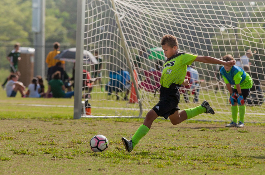Activity Ball Boys Competition Competitive Sport Day Goal Goalie Grass Green Color Kicking Leisure Activity Outdoors Playing Playing Field Soccer Soccer Ball Soccer Field Soccer Player Soccer Uniform Sport Sports Team Sports Uniform Sportsman Youth Soccer