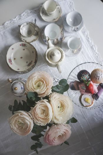Tea time White Background Top View Tea Time Tea Cup Tea - Hot Drink Tea Dessert Cakes Cake High Angle View Food Food And Drink Table Indoors  No People Variation Still Life Freshness Choice Sweet Food Indulgence Directly Above Sweet Large Group Of Objects Dessert Ready-to-eat