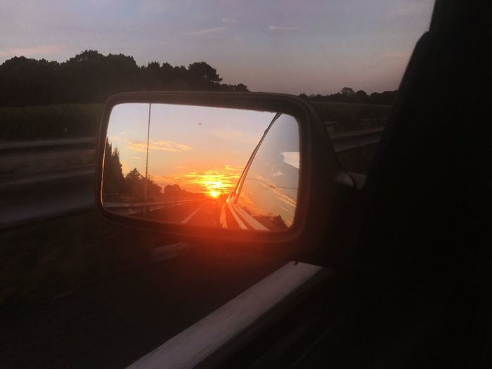 Sunset Transportation Car Sky Mode Of Transport Land Vehicle Window Side-view Mirror Sun Nature Sunlight No People Close-up Indoors  Day