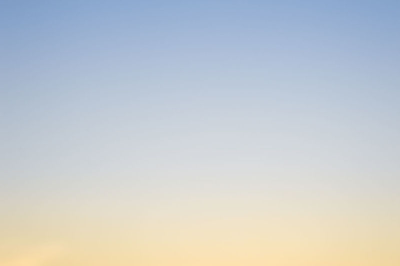Low angle view of clear sky at sunset