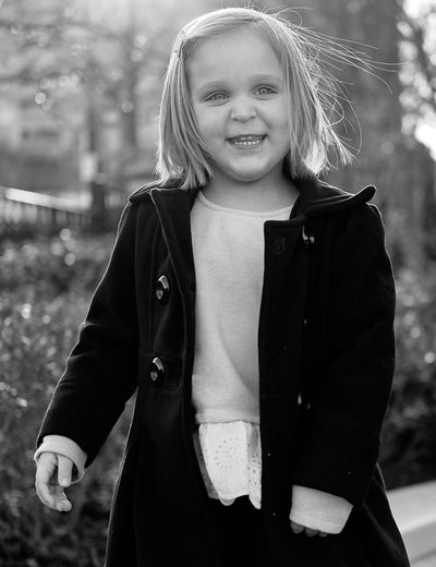 Welcome To Black Long Goodbye Portrait Front View Smiling Child Blond Hair Instagood Monochrome Black And White EyeEm Best Shots Outdoors City Relaxation Sweet Blackandwhite Photography Black And White Photography Long Goodbye The Portraitist - 2017 EyeEm Awards BYOPaper!