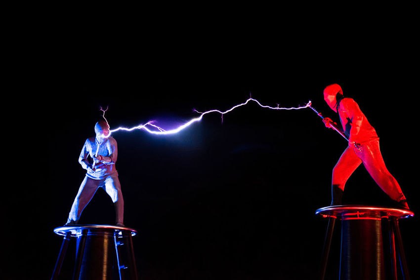 BONTIDA, ROMANIA - JULY 14, 2017: Lords of Lightning performing a high voltage electricity battle show at Electric Castle festival High Voltage Lords Of Lightning Power Red Show Strike Striking Ac Dc  Battle Black Background Black Sky Blue Charge Color Discharge Entertainment Festival Flash Illuminated Night Shock Thunder Thunderbolt Volt Voltage