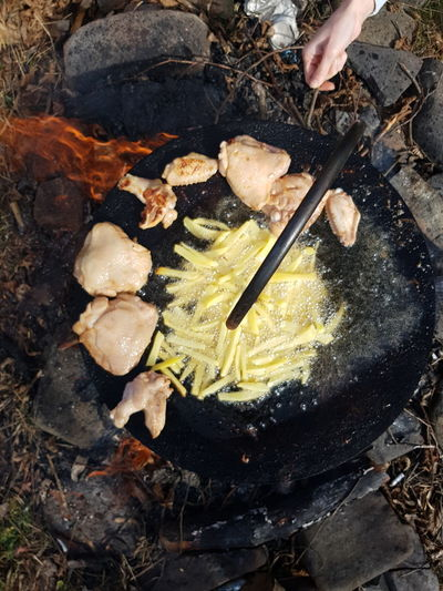 Bonfire Campfire Camping Close-up Directly Above Food Food And Drink Freshness Hand Heat - Temperature High Angle View Human Body Part Human Hand Kitchen Utensil Meat Nature People Preparation  Preparing Food Rock Rock - Object Solid Spoon