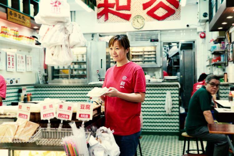 Waitress standing at restaurant