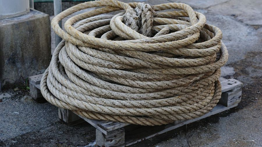 High angle view of ropes wound on pallet