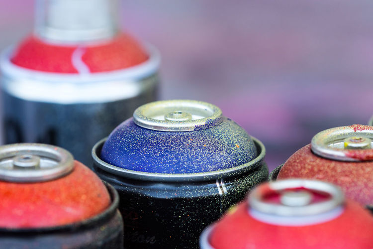 Close-Up Of Messy Spray Paint Cans