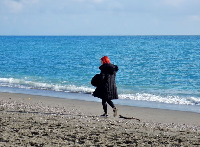 Sea Water Sky Horizon Over Water Beach Horizon Land Real People Scenics - Nature One Person Beauty In Nature Rear View Leisure Activity Lifestyles Full Length Nature Motion Day Outdoors Warm Clothing Amalfi Coast