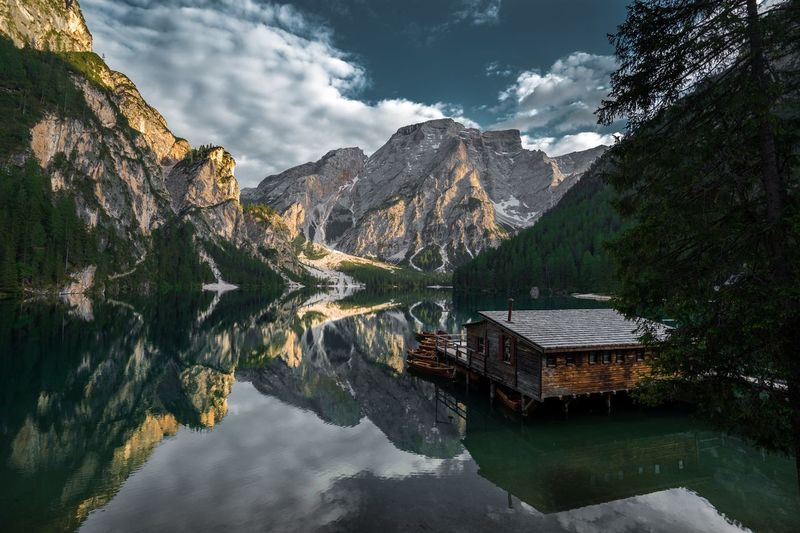 The last rays of sun caught on the Lago di Braies... Lago Sonyphotography Fullframe Lagodibraies Southtirol Lakeview Lake Italy Sunset Water Reflection Mountain Tree Nature Cloud - Sky Plant Lake Scenics - Nature Outdoors Sky Beauty In Nature Waterfront No People Day First Eyeem Photo The Great Outdoors - 2018 EyeEm Awards EyeEmNewHere
