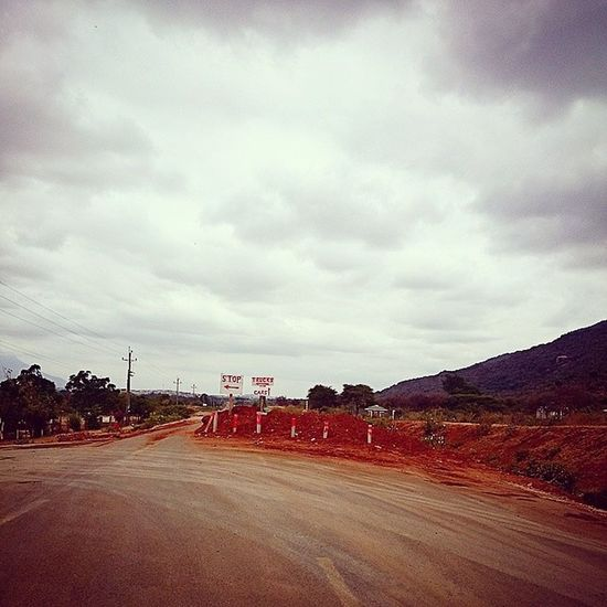 African Signs Diversion Deviation cloudy landscape redsoil pixels photography color crisp statigram webstagram igkenya border town