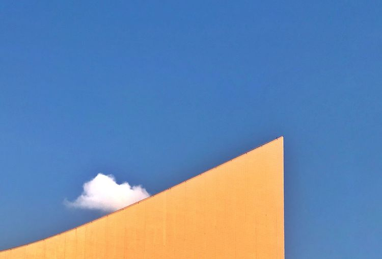 A fine day in the city Minimalism Cloud Sky Architecture Built Structure Blue Building Exterior Low Angle View Copy Space No People Building High Section Clear Sky Sunlight Outdoors Wall - Building Feature Day City Modern The Minimalist - 2019 EyeEm Awards The Mobile Photographer - 2019 EyeEm Awards The Architect - 2019 EyeEm Awards